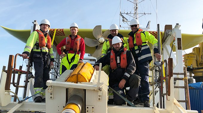 Members of the Minesto team works with the company's marine energy converter DG500 offshore Wales. Photo: Minesto